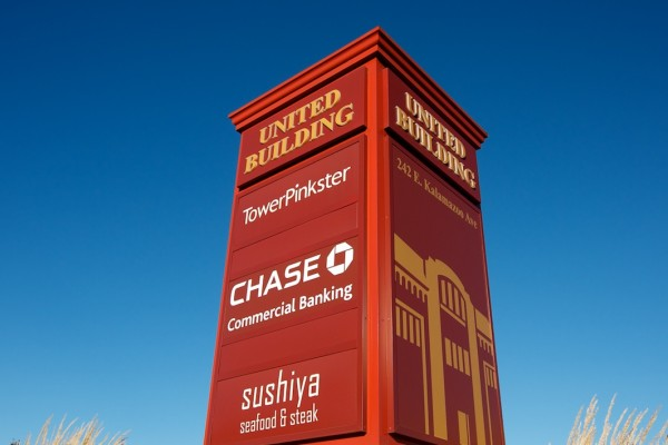 United Building illuminated monument sign featuring TowerPinkster, Chase and Sushya
