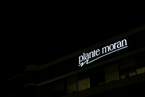 Plante Moran lit custom wall sign at night