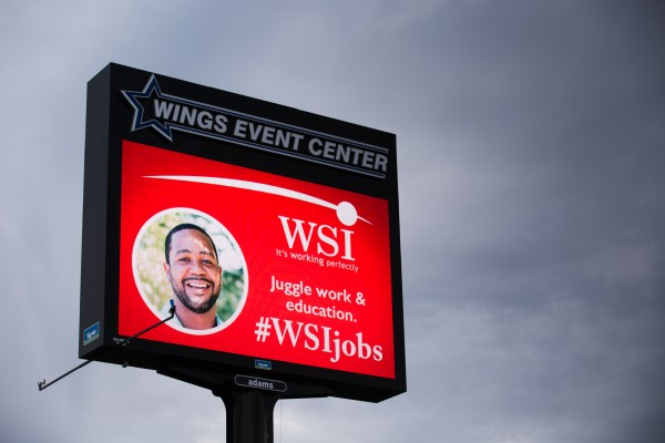 Wings Event Center custom highway sign with digital advertising LED message center featuring WSI