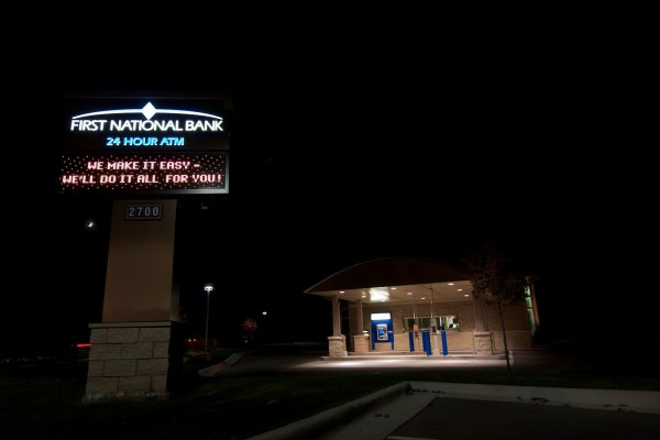First National Bank custom pylon sign with digital advertising electronic message center