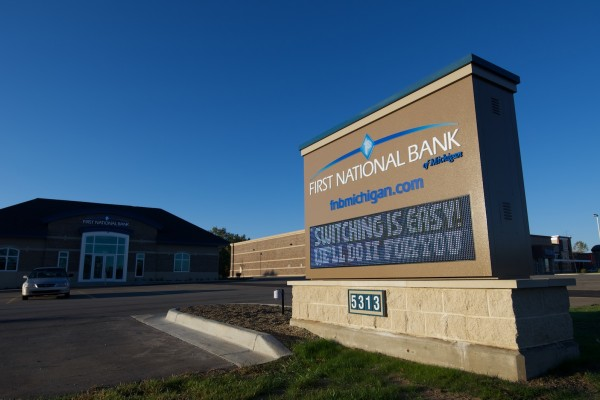 First National Bank of Michigan custom monument sign with digital advertising electronic message center