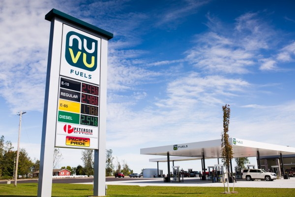 Nuvu Fuels custom pylon sign featuring Petersen Oil and Propane and Pacific Pride with digital gas pricing LED changers