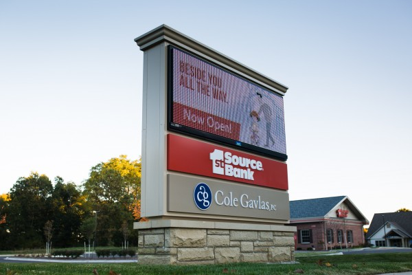 Multi-tenant custom monument sign featuring 1st Source Bank and Cole Gavlas PC with a digital advertising message center